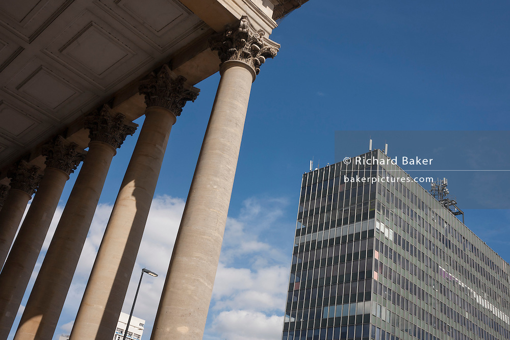 Neo-Roman Corinthian-topped columns of the Metropolitan Tabernacle and newer architecture at Elephant & Castle, south London.