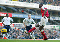 13/11/2004 - FA Barclays Premiership - Tottenham Hotspur v Arsenal - White Hart Lane<br />Arsenal's Lauren scores from a penalty<br />Photo:Jed Leicester/Back page images
