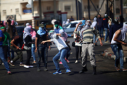 08.10.2015, Ramallah, PSE, Gewalt zwischen Palästinensern und Israelis, im Bild Zusammenstösse zwischen Palästinensischen Demonstranten und Israelischen Sicherheitskräfte // Palestinian protesters throw stones at Israeli security forces during clashes in Beit El, near the West Bank city of Ramallah. New violence rocked Israel and the Israeli occupied West Bank, including an incident in which men thought to be undercover Israeli police opened fire on Palestinian stone throwers they had infiltrated, wounding three of them, Palestine on 2015/10/08. EXPA Pictures © 2015, PhotoCredit: EXPA/ APAimages/ Shadi Hatem<br /> <br /> *****ATTENTION - for AUT, GER, SUI, ITA, POL, CRO, SRB only*****