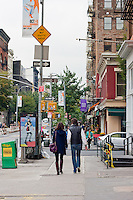 two people walking near grand st in New York City October 2008