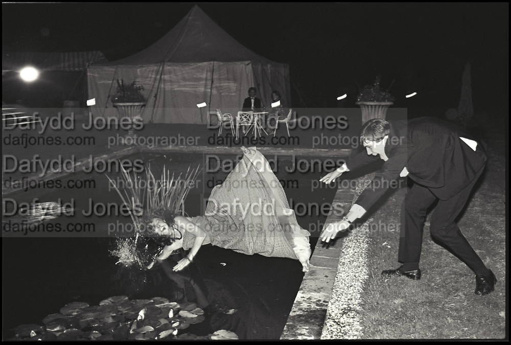Pop Vincent pushed in by Charles Mcdowel during the Martin Betts Dance. Ascot. 23 July 1982. Film 82660f12