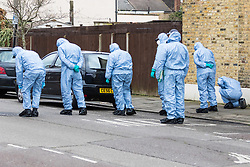 A forensics investigators conduct a fingertip search at the scene in Chalgrove Road, Tottenham, North London, where a seventeen year-old girl was shot dead on the evening of April 2nd. London, April 03 2018.