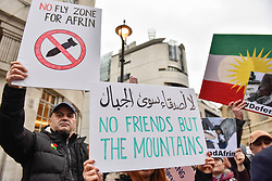 © Licensed to London News Pictures. 27/01/2018. LONDON, UK.  Protesters hold up signs outside the BBC as thousands of Kurdish people march from the BBC's Headquarters in Portland Place to Downing Street to protest against Turkey's military invasion of the city of Afrin in Northern Syria, a predominantly Kurdish city.  Protesters called for the British public to show solidarity with the people of Afrin and for the UK to demand that Turkey pull back its forces.  Photo credit: Stephen Chung/LNP