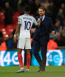 England's Marcus Rashford (left) manager Gareth Southgate (right) after the final whistle during the 2018 FIFA World Cup Qualifying, Group F match at Wembley Stadium, London. PRESS ASSOCIATION Photo. Picture date: Thursday October 5, 2017. See PA story SOCCER England. Photo credit should read: Mike Egerton/PA Wire. RESTRICTIONS: Use subject to FA restrictions. Editorial use only. Commercial use only with prior written consent of the FA. No editing except cropping.
