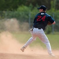 25 April 2010: Aaron Hornostaj of Rouen eyes third base during game 1/week 3 of the French Elite season won 12-4 by Rouen over the PUC, at the Pershing Stadium in Vincennes, near Paris, France.