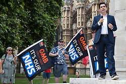 Richard Burgon, Labour MP for Leeds East, addresses NHS workers from the grassroots NHSPay15 campaign outside Parliament before a march to 10 Downing Street to present a petition signed by over 800,000 people calling for a 15% pay rise for NHS workers on 20th July 2021 in London, United Kingdom. At the time of presentation of the petition, the government was believed to be preparing to offer NHS workers a 3% pay rise in 'recognition of the unique impact of the pandemic on the NHS'.  Images)