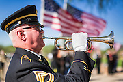 08 OCTOBER 2013 - PHOENIX, AZ: A US Army bugler performs Taps during a ceremony honoring the interment of the cremated remains of US military veterans in Phoenix. The cremated remains of 36 unclaimed US military veterans were interred at the National Memorial Cemetery in Phoenix. Members of the US military and several hundred veterans of the US military attended the service, which was a part of the Missing In America Project (MIAP).     PHOTO BY JACK KURTZ