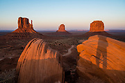 West and East Mitten Buttes and Merrick Butte at sunset in Monument Valley Navajo Tribal Park, Arizona, USA. The Western movie director John Ford set several popular films here.