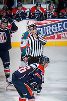 KELOWNA, CANADA - FEBRUARY 18: Referee Jeff Ingram stands at centre ice between the Kamloops Blazers and the Kelowna Rockets on February 18, 2015 at Prospera Place in Kelowna, British Columbia, Canada.  (Photo by Marissa Baecker/Shoot the Breeze)  *** Local Caption *** Jeff Ingram; referee; official;