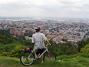 Cyclist at overlook above Bogota - Colombia
