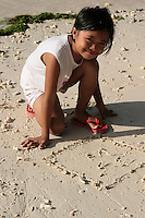 Filipino Kid Playing on the Beach - Filipinos, especially children, are well known for their exuberant personalities and a certain zest for life.