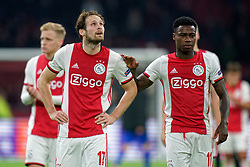 Daley Blind #17 of Ajax, Quincy Promes #11 of Ajax after the Europa League match R32 second leg between Ajax and Getafe at Johan Cruyff Arena on February 27, 2020 in Amsterdam, Netherlands