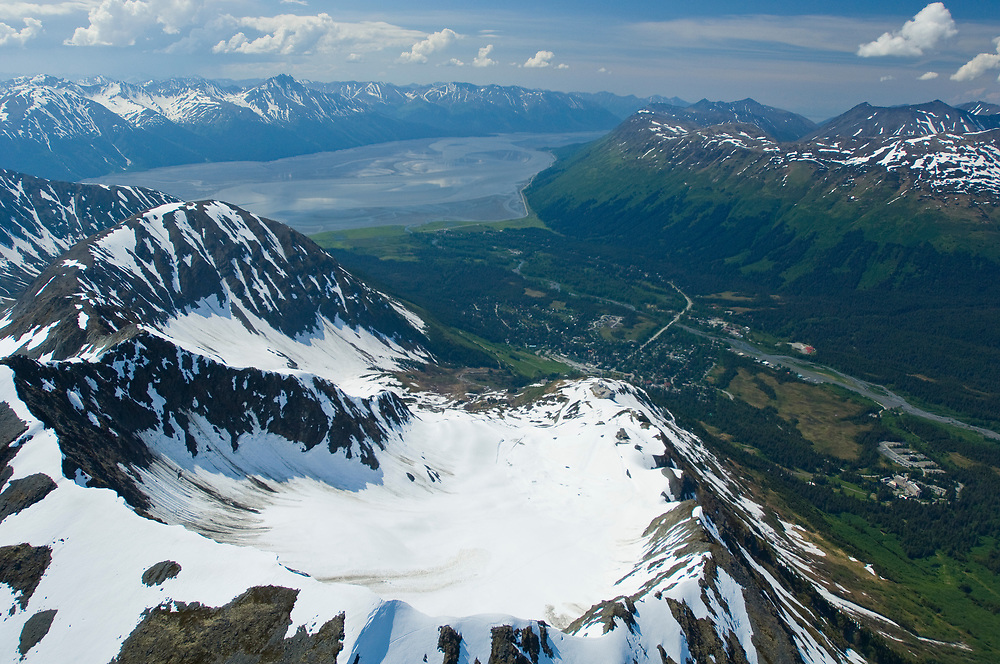 Community of Girdwood iin the base of Glacier Valley bordered by  Turnagain Arm  and the Chugach Mountains.  aerial spring.