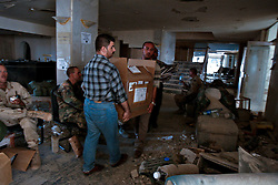 U.S. military, a Turkish search and rescue team, and UN officials comb the site of the explosion at the Canal Hotel for bodies in Baghdad, Iraq on Aug. 21, 2003. Earlier in the week a cement truck packed with explosives detonated outside the offices of the UN headquarters in Baghdad, Iraq, killing 20 people and devastating the facility in an unprecedented suicide attack against the world body. At least 100 people were wounded.