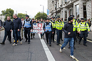 Police lead the march during the Football Lads Alliance march between Park Lane and Westminster Bridge, London on 7 October 2017. Photo by Phil Duncan.