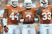 AUSTIN, TX - AUGUST 31: Jackson Jeffcoat #44, Jordan Hicks #3 and Steve Edmond #33 of the Texas Longhorns looks on against the New Mexico State Aggies on August 31, 2013 at Darrell K Royal-Texas Memorial Stadium in Austin, Texas.  (Photo by Cooper Neill/Getty Images) *** Local Caption *** Jackson Jeffcoat; Jordan Hicks; Steve Edmond