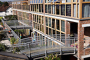View of one of some of the flats in the BedZED housing complex on Thursday, Sep. 6, 2007, in London, UK. BedZED or the Beddington Zero Energy Development, is an environmentally-friendly housing development near Wallington, England in the London Borough of Sutton. It was designed by the architect Bill Dunster who was looking for a more sustainable way of building housing in urban areas in partnership between the BioRegional Development Group and the Peabody Trust. There are 82 houses, 17 apartments and 1,405 square meters of work space were built between 2000. The project was shortlisted for the Stirling Prize in 2003. The project is designed to use only energy from renewable source generated on site. In addition to 777 square meters of solar panels, tree waste is used for heating and electricity. The houses face south to take advantage of solar gain, are triple glazed and have high thermal insulation while most rain water is collected and reused. Appliances are chosen to be water efficient and use recycled water wherever possible. Low impact building materials were selected from renewable or recycled sources and were all originating within a 35 mile radius of the site to minimize the energy required for transportation. Also, refuse collection facilities are designed to support recycling and the site encourage eco-friendly transport: electric and LPG cars have priority over petrol/diesel cars, and electricity is provided by parking spaces appositely built for charging electric cars.