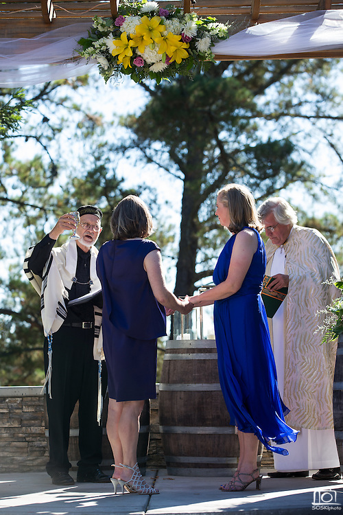 A couple celebrates their same sex wedding at Wedgewood Napa at Kennedy Park in Napa, California, on July 30, 2016. (Stan Olszewski/SOSKIphoto)