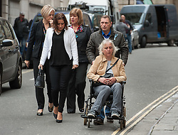 © Licensed to London News Pictures. 11/11/2015. Bristol, UK.  DARREN GALSWORTHY the father of murder victim Rebecca Watts, wheels his wife ANJIE GALSWORTHY, the mother of Nathan Matthews who is accused of Becky Watts' murder, into Bristol Crown court on the day the jury retires to consider their verdict in the Rebecca Watts' murder trial, accompanied by Becky's aunt SARAH BROOM (white jacket).  Photo credit : Simon Chapman/LNP