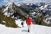 Parmenter and Liana Welty hike up to Maple Pass, North Cascades Scenic Highway Corridor, Washington. Lake Ann is visible in the basin below.