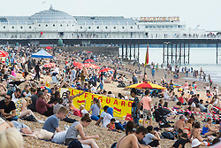 © Licensed to London News Pictures. 29/08/2016. Brighton, UK. Members of the public spent the last day of the August Bank Holiday on the beach in Brighton. Photo credit: Hugo Michiels/LNP