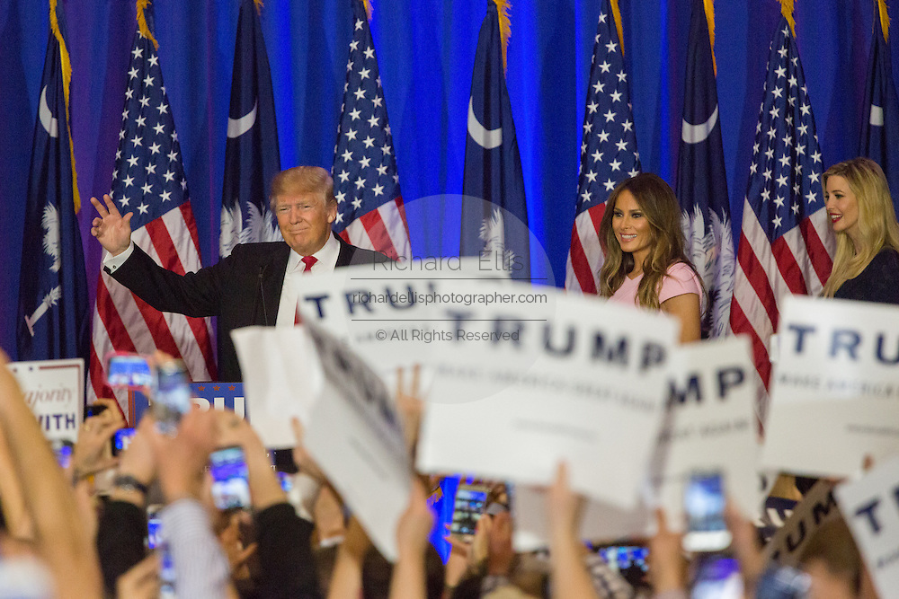 Billionaire and GOP presidential candidate Donald Trump waves to cheering supporters along with his wife Melania and daughter Ivanka as they celebrate victory in the South Carolina Republican primary February 20, 2016 in Spartanburg, South Carolina, USA .