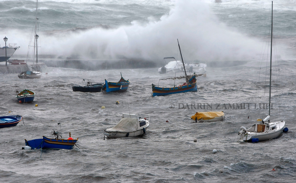 Waves crash over the breakwater in Spinola Bay causing several small boats to slip their moorings in St Julian's, outside Valletta, January 24, 2008.  Strong winds and rough seas caused considerable damage on the Maltese islands on Thursday, though only a handful of minor injuries were reported, police said...REUTERS/Darrin Zammit Lupi (MALTA)..MALTA OUT