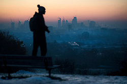 © Licensed to London News Pictures. 12/12/2017. London, UK. A view over the city of London at sunrise from Hampstead Heath in north London on a freezing morning. Temperatures across the the UK dipped overnight with some regions expected to drop to -13C (9F). Photo credit: Ben Cawthra/LNP