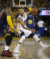 June 1, 2017 - Oakland, CA, USA - The Golden State Warriors' Stephen Curry works off the dribble against the Cleveland Cavaliers' LeBron James, left, in the second quarter during Game 1 of the NBA Finals at Oracle Arena in Oakland, Calif., on Thursday, June 1, 2017. (Credit Image: © Nhat V. Meyer/TNS via ZUMA Wire)