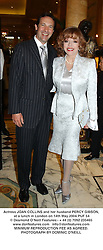Actress JOAN COLLINS and her husband PERCY GIBSON, at a lunch in London on 14th May 2004.PUF 54
