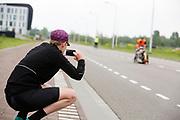 Iris Slappendel fotografeert Aniek Rooderkerken in de Velox. Op een weg op de campus van de TU Delft oefent het team met het rijden in een Velox. In september wil het Human Power Team Delft en Amsterdam, dat bestaat uit studenten van de TU Delft en de VU Amsterdam, tijdens de World Human Powered Speed Challenge in Nevada een poging doen het wereldrecord snelfietsen voor vrouwen te verbreken met de VeloX 7, een gestroomlijnde ligfiets. Het record is met 121,44 km/h sinds 2009 in handen van de Francaise Barbara Buatois. De Canadees Todd Reichert is de snelste man met 144,17 km/h sinds 2016.<br /> <br /> With the VeloX 7, a special recumbent bike, the Human Power Team Delft and Amsterdam, consisting of students of the TU Delft and the VU Amsterdam, also wants to set a new woman's world record cycling in September at the World Human Powered Speed Challenge in Nevada. The current speed record is 121,44 km/h, set in 2009 by Barbara Buatois. The fastest man is Todd Reichert with 144,17 km/h.