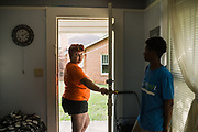 MONTGOMERY, AL – JUNE 11, 2019: Myra Powell (left) stands in the apartment she rents with her fiancé, Stefvenie Buckner, in the Capitol Heights neighborhood. At age 19, while 26 weeks pregnant, Powell suffered a catastrophic placental abruption and was taken by ambulance to a nearby hospital. While there, doctors discovered her placenta had fully detached from the uterine wall, depriving her twin boys of oxygen. Silas and Stefvon died in utero. Narrowly escaping death herself, Powell would later be diagnosed with HELLP syndrome, a pregnancy-induced blood pressure condition in the eclampsia family that kills nearly a third of all women who develop it. As a young, poor, black woman from the south, Powell represents the deadliest cross-section of demographics among mothers in America, where more women die from pregnancy related causes than any other wealthy country in the world.