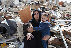 March 27, 2019 - Gaza City, Gaza Strip, Palestinian Territory - Palestinians inspect their house that demolished two days ago by an Israeli airplane, in Gaza city, on March 27, 2019.Palestinian Minister of Public Works and Housing, Mufid al-Hasayneh, said that recent Israeli airstrikes on the besieged Gaza Strip left 30 residential structures completely destroyed, and at least 500 other others partially damaged  (Credit Image: © Mahmoud Ajjour/APA Images via ZUMA Wire)