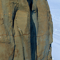 Conrad Anker & Alex Lowe climb the summit spire of The Troll's Castle, in the Filchner Mountains, Queen Maud Land, Antarctica.