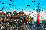 Kevin Bartram   Staff<br /> Rides are seen through a rain-covered window during the final day of the Berlin Fair on Sunday at the fairgrounds in Berlin.