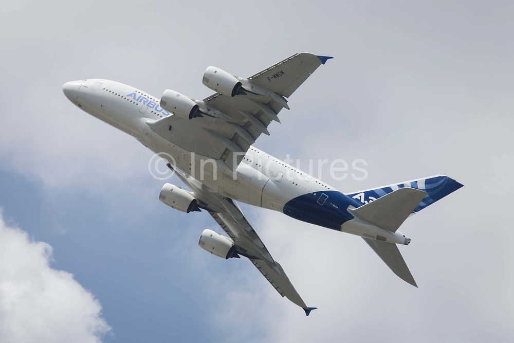 Airbus A380 demonstrating flying skills at the Farnborough Air Show, England. The Airbus A380 is a double-deck, wide-body, four-engine jet airliner manufactured by Airbus. It is the world's largest passenger airliner, and many airports have upgraded facilities to accommodate its size. Airbus is an aircraft manufacturing division of Airbus Group (formerly European Aeronautic Defence and Space Company). Based in Blagnac, France, a suburb of Toulouse, with production and manufacturing facilities mainly in France, Germany, Spain and the United Kingdom, the company produced 626 airliners in 2013. At the 2014 show, Airbus announced new business worth more than $75m for 496 aircraft, a new record for the company.