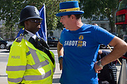 Pro remain campaigner Steve Bray speaks with a police officer outside the Cabinet office in Whitehall, London, United Kingdom on 22nd August 2019. Inside ministers are discussing Brexit at a daily Brexit Cabinet Meeting.