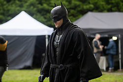 © Licensed to London News Pictures. 13/10/2020. Liverpool, UK. Batman and Catwoman stunt doubles film scene at Anfield Cemetery, Liverpool for The Batman movie. Photo credit: Kerry Elsworth/LNP
