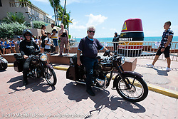 Texan Stewart Garrison stops with his 1948 restored Twin Cylinder Triumph beside the southernmost point buoy marker in Key West on the Cross Country Chase motorcycle endurance run from Sault Sainte Marie, MI to Key West, FL. (for vintage bikes from 1930-1948). Riding through town just before at the end of the 110 mile Stage-10 ride from Miami to Key West, FL USA. Sunday, September 15, 2019. Photography ©2019 Michael Lichter.