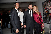 VLADIMIR RESTOIN ROITFELD; TOM FORD; ; CARINE ROITFELD;  , Private view of the exhibition ' Mother of Pouacrus' by Nicholas Pol. Presented by Vladimir Restoin Roitfeld. The Old Dairy, Wakefield St.  London. 14 October 2010. <br /> <br /> -DO NOT ARCHIVE-© Copyright Photograph by Dafydd Jones. 248 Clapham Rd. London SW9 0PZ. Tel 0207 820 0771. www.dafjones.com.