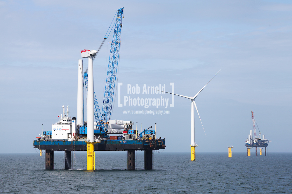 © Rob Arnold.  09/04/2014. North Wales, UK. Wind turbine installation jack up barges, Sea Jack (left) and Sea Worker (right), installing wind turbines on the Gwynt y Môr Offshore Wind Farm off the coast of North Wales. Photo credit : Rob Arnold
