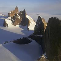 ANTARCTICA, Queen Maud Land.  Fenris Mountains.  Front to Rear: Holtanna (2650m), Holsttind (2577m), Kinntanna (2721m) & Ulvetanna (2931m)  (looking north)