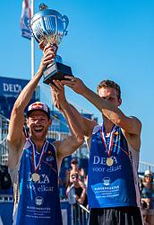 25-08-2019 NED: DELA NK Beach Volleyball, Scheveningen<br /> Last day NK Beachvolleyball / Alexander Brouwer #1 and Christiaan Varenhorst Dutch Champion Beachvolleyball 2019