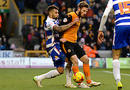 James Henry battles with Hal Robson-Kanu during the Sky Bet Championship match between Wolverhampton Wanderers and Reading at Molineux, Wolverhampton, England on 7 February 2015. Photo by Alan Franklin.