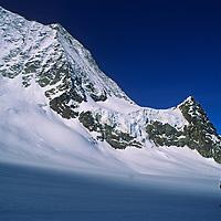 Jay Jensen and Allan Pietrasanta cross a glacier on the classic Haute Route ski tour through the Alps between Chamonix, France and Zermatt, Switzerland.