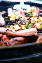 Etreme close up of barbeque grill with vegetables and meats