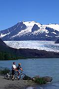 Couple biking, Mendenhall Glacier, Juneau, Alaska<br />
