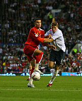 Photo: Andrew Unwin.<br />England v Macedonia. UEFA European Championships 2008 Qualifying. 07/10/2006.<br />England's Steven Gerrard (R) competes with Macedonia's Aleksandar Mitreski (L).