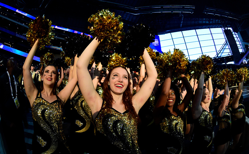 Central Florida University band and spirit members perform after the Chick-fil-A Peach Bowl NCAA college football game at the Mercedes-Benz Stadium in Atlanta, January 1, 2018. UCF won 34-27 to go undefeated for the season. (David Tulis via Abell Images for Chick-fil-A Peach Bowl)