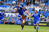 Declan John of Cardiff city (l) gets to the ball ahead of Yeni Ngbakoto of Queens Park Rangers (c). EFL Skybet championship match, Cardiff city v Queens Park Rangers at the Cardiff city stadium in Cardiff, South Wales on Sunday 14th August 2016.<br /> pic by Andrew Orchard, Andrew Orchard sports photography.